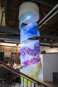 The Spiral Screen print on Dura-Lar, wooden cylinder, color changing LED light, and soundscape. 14' x 4' diameter
